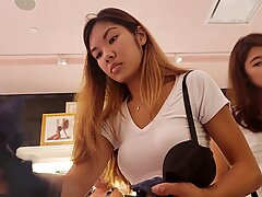 Asian girl in the store, frontal upskirt