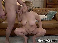 Buxom mature woman sucks