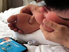 Sleeping boy feet being pricked