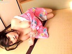 Young bosomy Japanese bitch Megu Fujiura shows off her milky tits