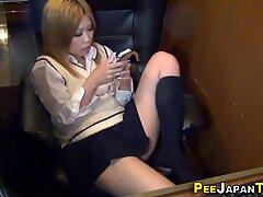 Asian teen wets herself
