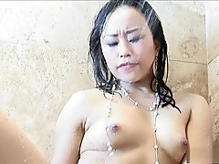 Two wonderful lesbian lovers have fun with a huge dildo in the shower