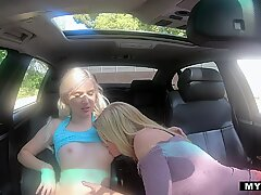 Teen & MILF Team up for Scissoring Session in Car!Report this video